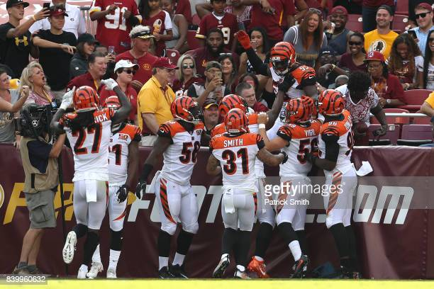 Outside linebacker Vontaze Burfict of the Cincinnati Bengals celebrates an interception returned for a touchdown against the Washington Redskins in...