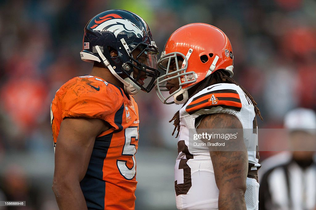 Outside linebacker Wesley Woodyard #52 of the Denver Broncos and running back Trent Richardson #33 of the Cleveland Browns exchange words after a play during a game at Sports Authority Field Field at Mile High on December 23, 2012 in Denver, Colorado. The Broncos defeated the Browns 34-12.