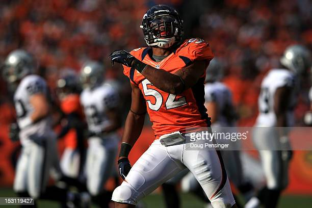 Outside linebacker Wesley Woodyard of the Denver Broncos celebrates after tackling running back Mike Goodson of the Oakland Raiders to bring up a...