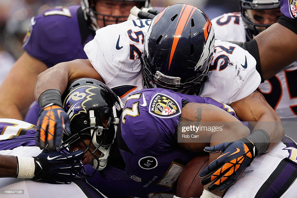Outside linebacker Wesley Woodyard #52 of the Denver Broncos tackles running back Ray Rice #27 of the Baltimore Ravens during the first half at M&T Bank Stadium on December 16, 2012 in Baltimore, Maryland.