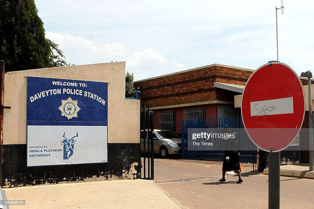 Outside of the Daveyton Police station on February 28, 2013 in Daveyton, South Africa. A Mozambican taxi driver, Mido Macia was handcuffed to the back of a police van and dragged for about 500m to the police station, where he later died. The officers involved have been suspended.