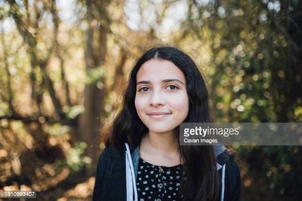 outside portrait of a young teen girl with a sweet closed mouth smile - thousand oaks stock pictures, royalty-free photos & images