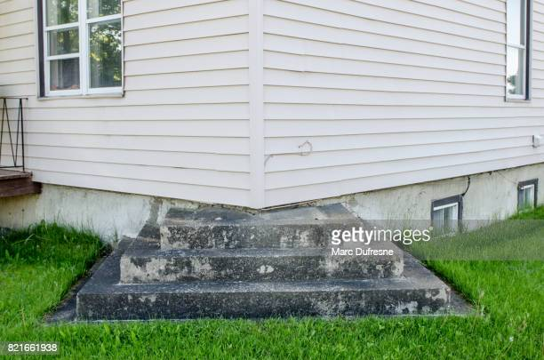 Outside residential step leading to corner of house with no door