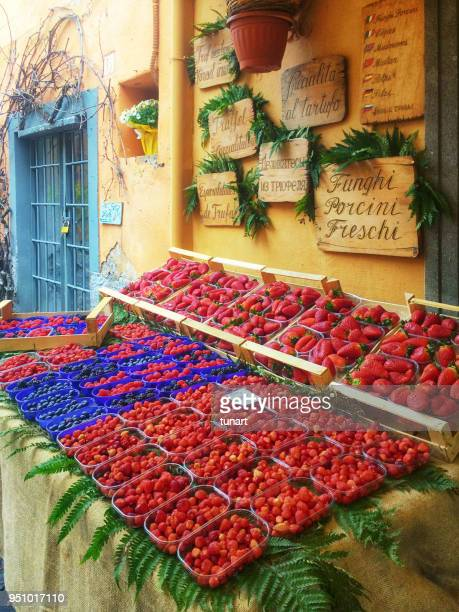 outside stall of a berry shop in nemi, rome, italy - lazio foto e immagini stock