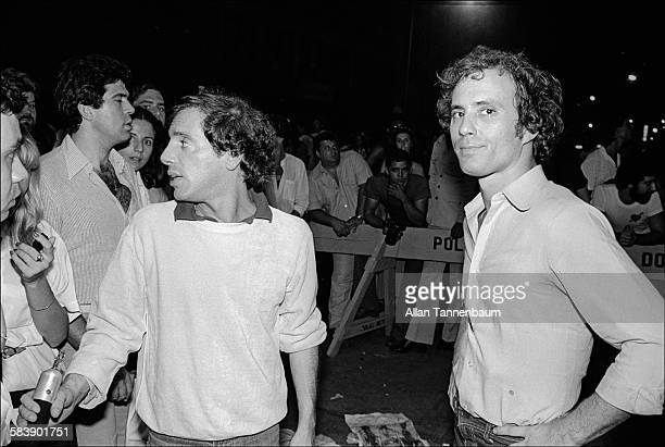 Outside Studio 54 owners Steve Rubell and Ian Schrager check out wouldbe clubgoers New York New York July 20 1978