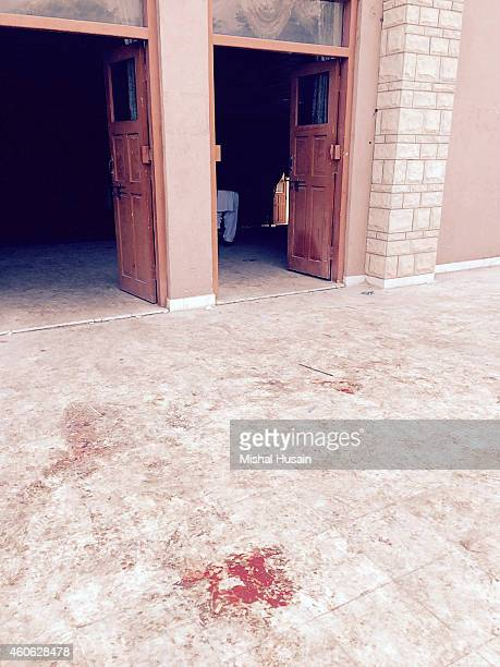 Outside the auditorium of an armyrun public school that was targeted by Taliban militants in a deadly assault that claimed the lives of 141 students...