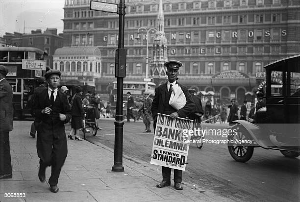 Outside the Charing Cross Hotel, London an Evening Standard newspaper vendor carries a poster saying 'Hatry Crisis, Banks Dilemma', referring to...