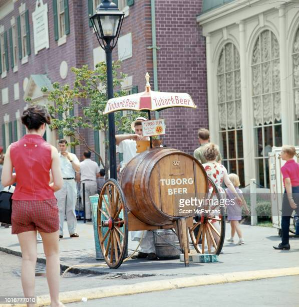 Outside the Denmark Pavilion a vendor sells Tuborg Beer to tourists at the World's Fair in Flushing Meadows Park Queens New York New York June 1965