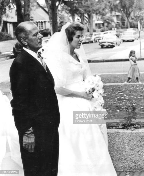 Outside the entrance of St Thomas Episcopal Church Saturday Miss Penny Bosworth speaks with her father Arthur F Bosworth before her marriage to...