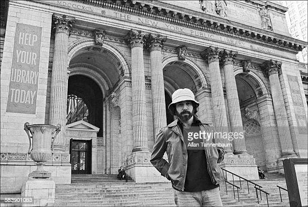 Outside a New York Public Library American musician Paul Simon promotes a NY Public Library benefit concert New York New York April 25 1976