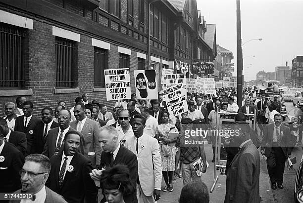 Outside the opening session of the 1960 Republican National Convention an orderly crowd of demonstrators urges the party at adopt a strong civil...