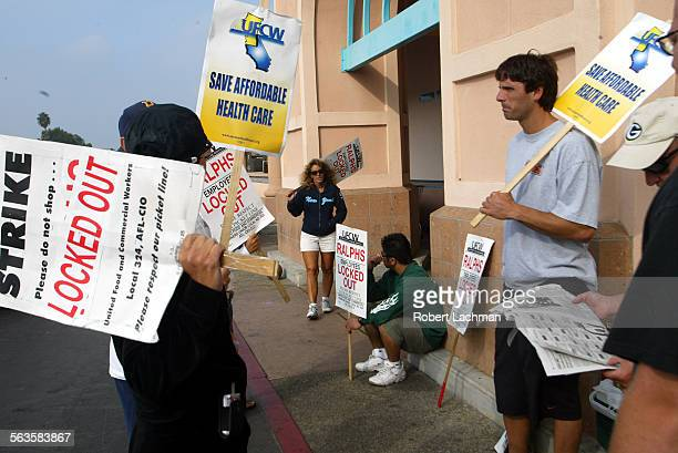 Outside the Ralphs market on Warner Ave in Huntington Beach striking workers hold signs at the entrance during the third week of the strike