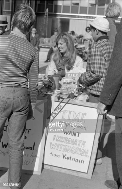 Outside the Time Life Building during the Moratorium to End the War in Vietnam demonstration a woman staffs a table as people sign petitions New York...