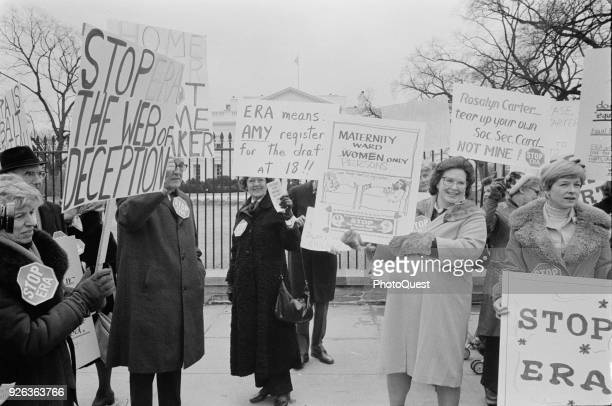 Outside the White House a group of demonstrators many with signs protest against the Equal Rights Amendment Washington DC February 4 1977 Among the...