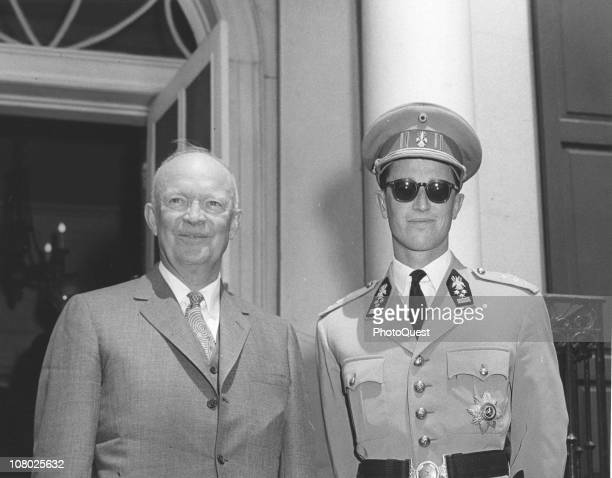 Outside the White House, US President Dwight Eisenhower poses with King Baudouin of Belgium while on a royal state visit to the United States, May...