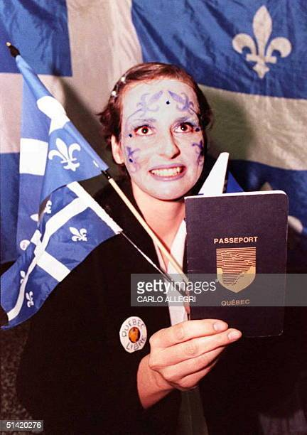 Outside the Yes Party Headquarters a yes supporter shows what she thinks the Quebec passport will look like if Quebecers decide to leave Canada in...