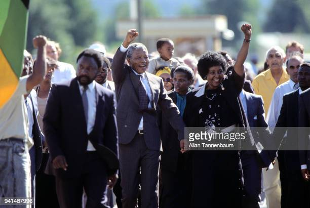 Outside Victor Verster prison married South African antiapartheid activists Nelson Mandela and Winnie Mandela raise their fists as they celebrate...