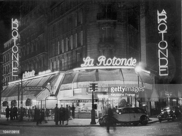 Outside view at night of the restaurant LA ROTONDE in the Montparnasse district of Paris in 1939