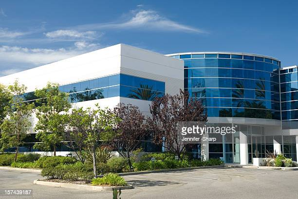outside view of a office building with blue windows - office building exterior stock pictures, royalty-free photos & images