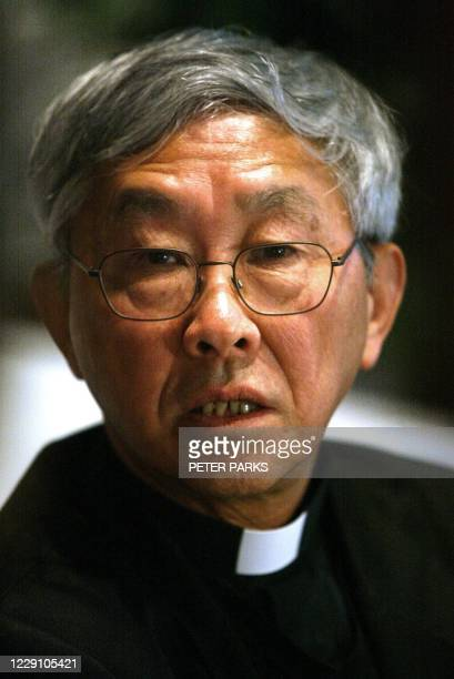 Outspoken leader of the Catholic Church in Hong Kong Bishop Joseph Zen listens to reporters' questions as he faces the press after speaking at the...
