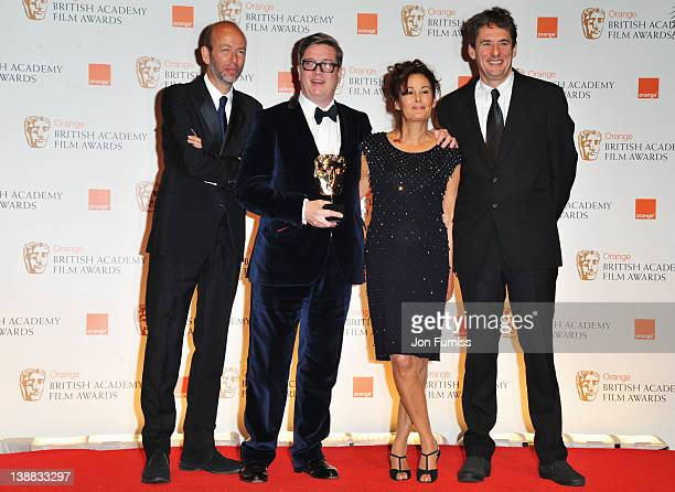 Outstanding British Film winners Tomas Alfredson Tim Bevan Eric Fellner and Robyn Slovo pose during the Orange British Academy Film Awards 2012 at...