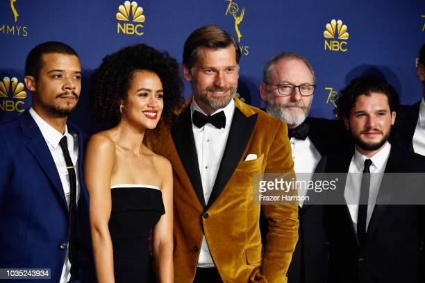 Outstanding Drama Series winners Jacob Anderson Nathalie Emmanuel Nikolaj CosterWaldau Liam Cunningham and Kit Harington pose in the press room...