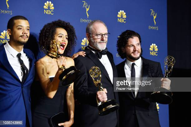 Outstanding Drama Series winners Jacob Anderson Nathalie Emmanuel Liam Cunningham and Kit Harington pose in the press room during the 70th Emmy...