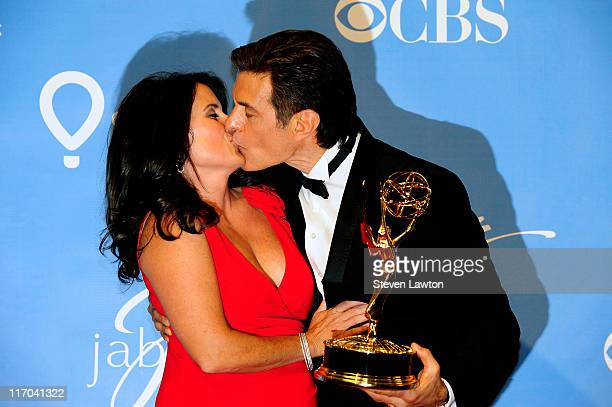 Outstanding Informative Talk Show award winner Dr Mehmet Oz and Lisa Oz kiss in the press room at the 38th Annual Daytime Emmy Awards held at the Las...