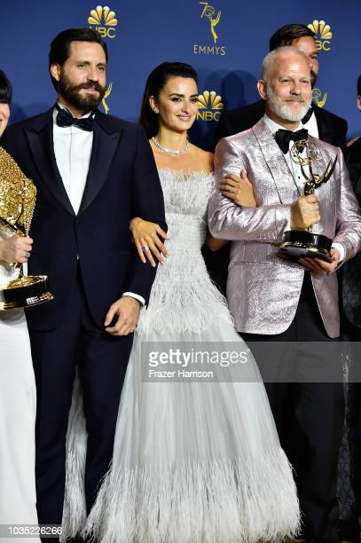 Outstanding Limited Series winners Edgar Ramirez Penelope Cruz and Ryan Murphy pose in the press room during the 70th Emmy Awards at Microsoft...