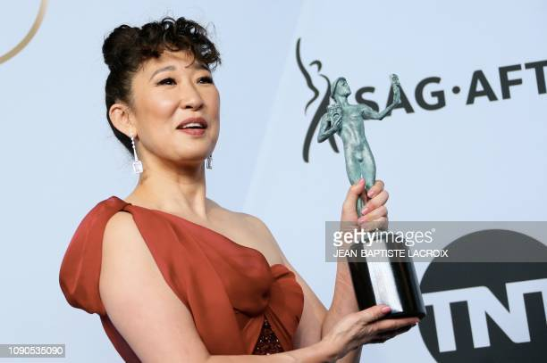 TOPSHOT Outstanding Performance by a Female Actor in a Drama Series for Killing Eve winner Sandra Oh poses in the press room during the 25th Annual...