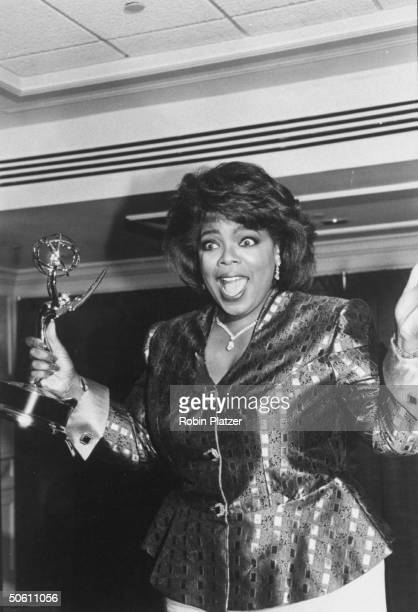 Outstanding Talk Show Host winner Oprah Winfrey looking excited backstage at the Daytime Emmy Awards.