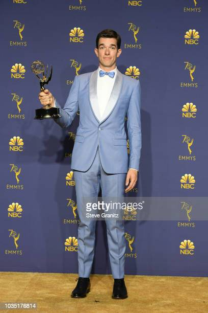 Outstanding Writing for a Variety Special winner John Mulaney poses in the press room during the 70th Emmy Awards at Microsoft Theater on September...