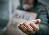 Outstretched hand of pathetic beggar