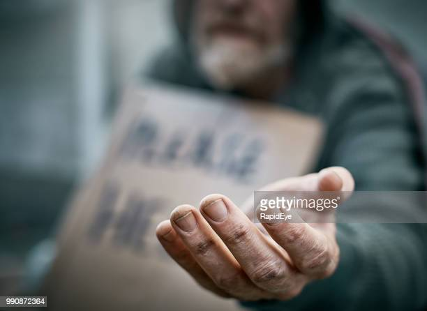 outstretched hand of pathetic beggar - homeless foto e immagini stock