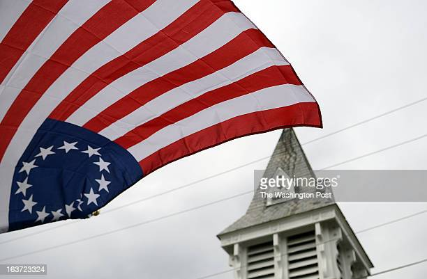 13 outwardlyoriented fivepointed stars arranged in a circle make up the socalled Betsy Ross flag placed near the St James United Church of Christ in...