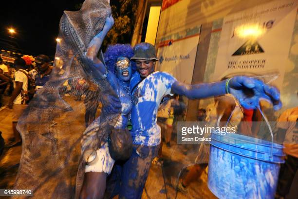 J'ouvert revellers covered in blue paint dance and parade with the Rapso music band 3canal during the 20th anniversary celebration of their song Blue...