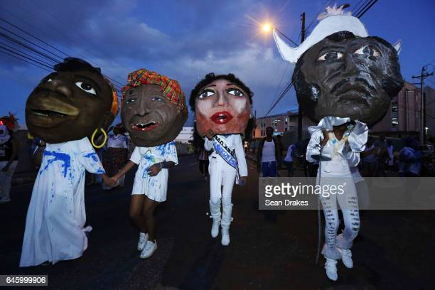 J'ouvert revellers parade with Return of the Black Jacobins band during Trinidad Carnival on February 27 2017 in Port of Spain Trinidad