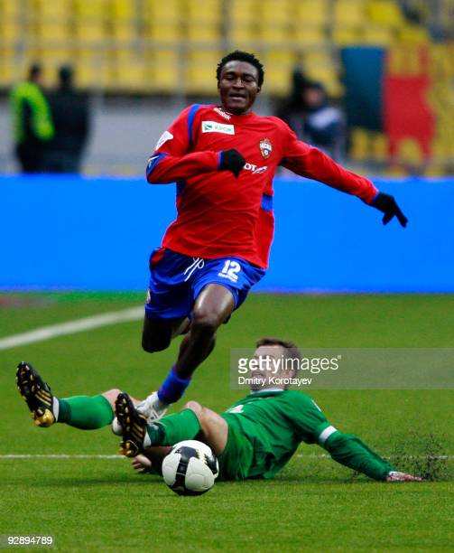 Ouwo Moussa Maazou of PFC CSKA Moscow evades a tackle by Sergei Semak of FC Rubin Kazan during the Russian Football League Championship match between...