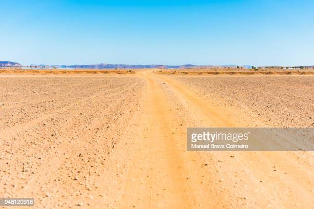 ouzina desert - thoroughfare stock photos and pictures