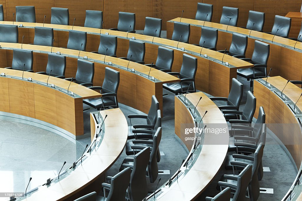 Oval conference room with rows of seats : Stock Photo