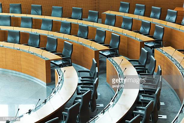 oval conference room with rows of seats - overheid stockfoto's en -beelden