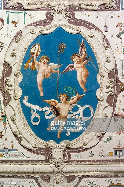 Oval depicting three putti detail of the Hall of Grotesques' ceiling Della Manta Castle Manta Piedmont Italy 13th16th century