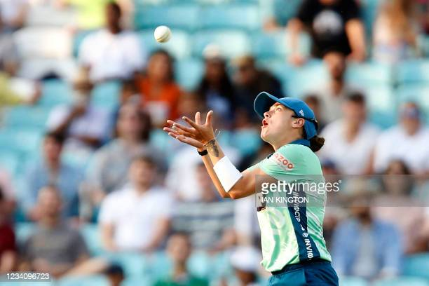 Oval Invincibles' Grace Gibbs makes the catch to take the wicket of Manchester Originals' Lizelle Lee for 42 during the inaugural match of the new...