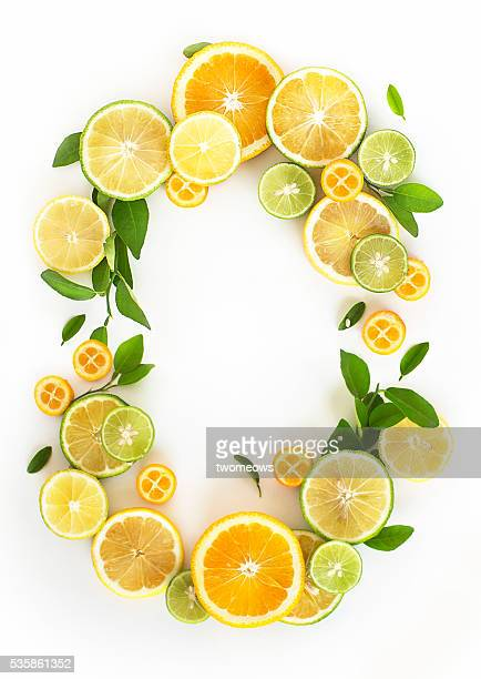 Oval shape ornament form by citrus fruits and leaves.