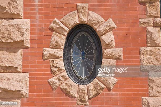 oval stained-glass window on building facade - cambridge massachusetts stock pictures, royalty-free photos & images