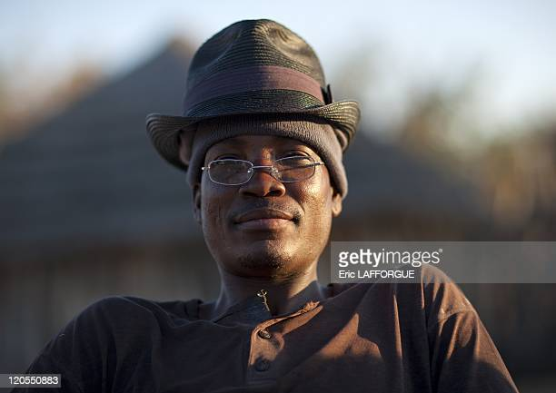 Ovambo Man Wearing A Hat, in Ruacana Area, Namibia on August 08, 2010 - Ovambo people are farmers living in Angola. They build high wooden faces...