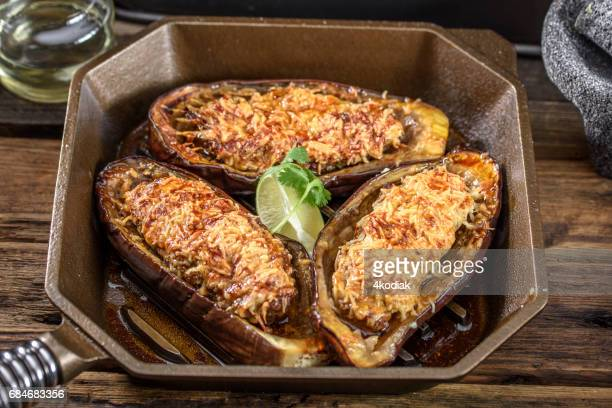 Oven Baked Beef Stuffed Eggplant in a cast iron pan