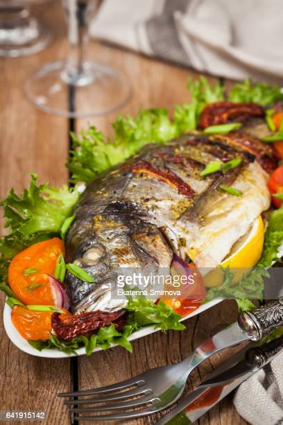 oven baked whole sea bream fish - roasted pepper stock photos and pictures