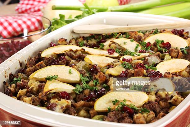 oven dish full with meat stuffing with apple slices - stuffing stock photos and pictures