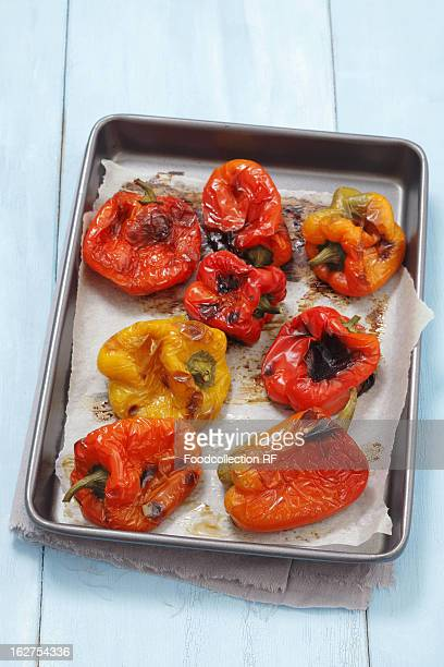 oven roasted peppers in baking tray - roasted pepper stock photos and pictures